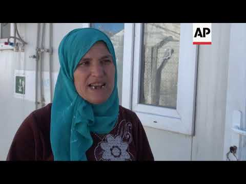 Kurdish families stay in camp rather than going home