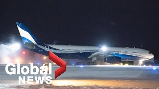 Coronavirus: Plane carrying Canadian evacuees from China outbreak arrives at CFB Trenton