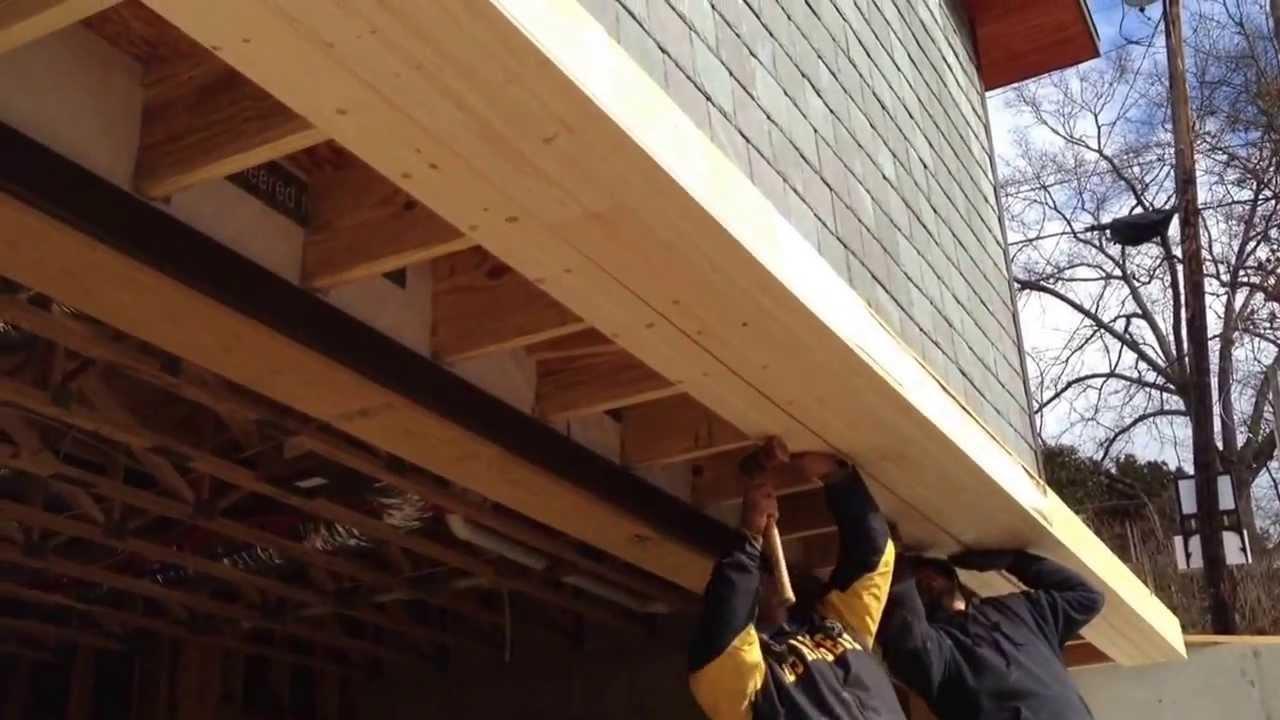 Building a Roof Over the Garage Door - YouTube