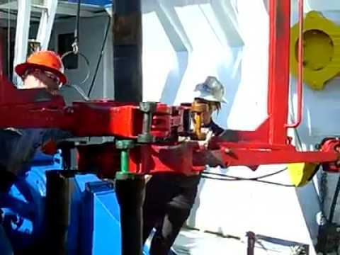 Woman on a drilling rig making connections