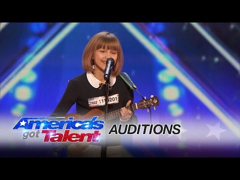 "A 12-year-old ukulele player gets the golden buzzer when she takes a risk and performs an original tune, ""I Don't Know My Name."""