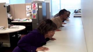 APHA staff members demonstrate their exercise program