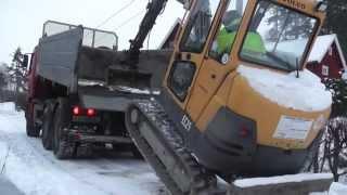 Volvo mini excavator climbing truck.