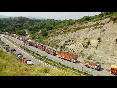 Heavy vehicles stranded on Srinagar-Jammu national highway on third day due to land sliding near Udh