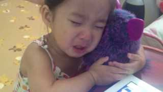 Melody crying when her favorite pet Furby ran out of batteries...thinking he
