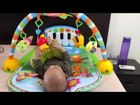 KABIR PLAYING IN HIS PLAY GYM   AT 5 MONTHS