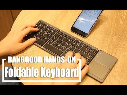 WIRELESS MINI KEYBOARD with touchpad for smartphones, tablets and laptops