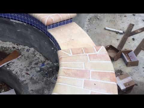 Nics Pool Construction LLC big brick and tile job Charlie Merrell design Tampa Florida