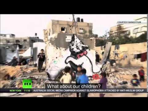 Banksy in GAZA 'Haunting Images Among Ruins Of WAR'