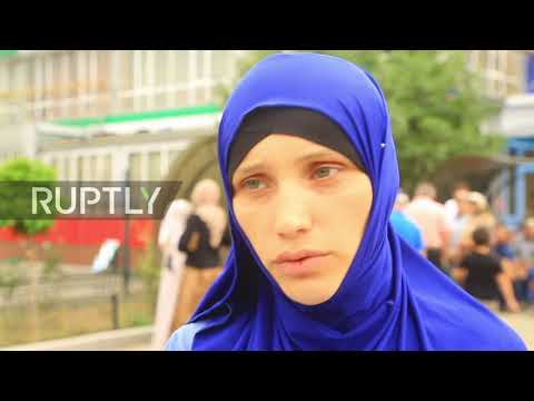 Russia: Tears and hugs as orphaned children of foreign IS fighters return from Iraq to Grozny