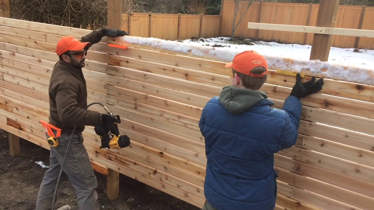 Horizontal cedar fence building in seattle snow
