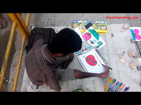 Street artist at work in Bangalore, India