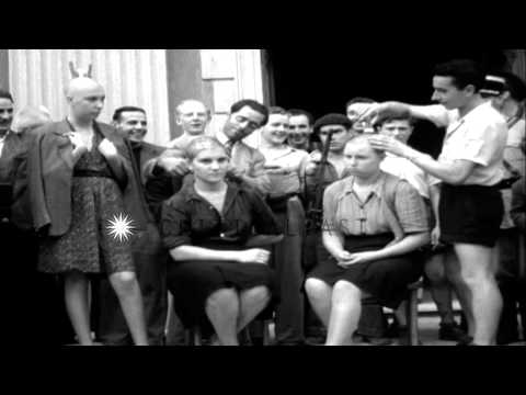 Barber shaves heads of French, female Nazi-collaborators in Menton, France HD Stock Footage