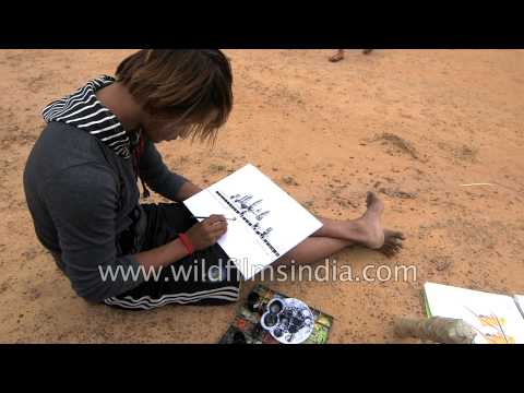 An artist works on watercolour at a beach side in Cambodia