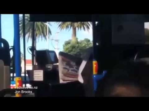 Bus driver reads NEWSPAPER whilst driving the bus