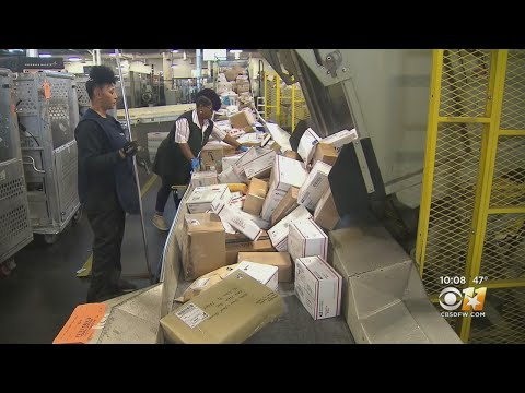 Behinds The Scenes As Texas USPS Workers Handle The Holiday Rush