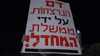 מפגינים בעצרת נגד רצח ואלימות נשים בכיכר רבין בתל אביב