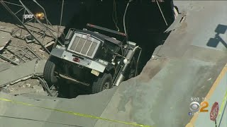 Dump Truck Plunges Through Parking Garage