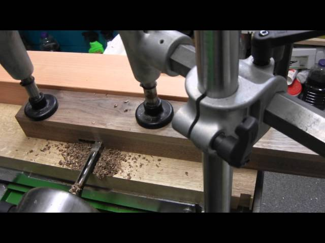 Felder FD250 Horizontal bore machine cutting walnut cupboard leg mortise for lower rail