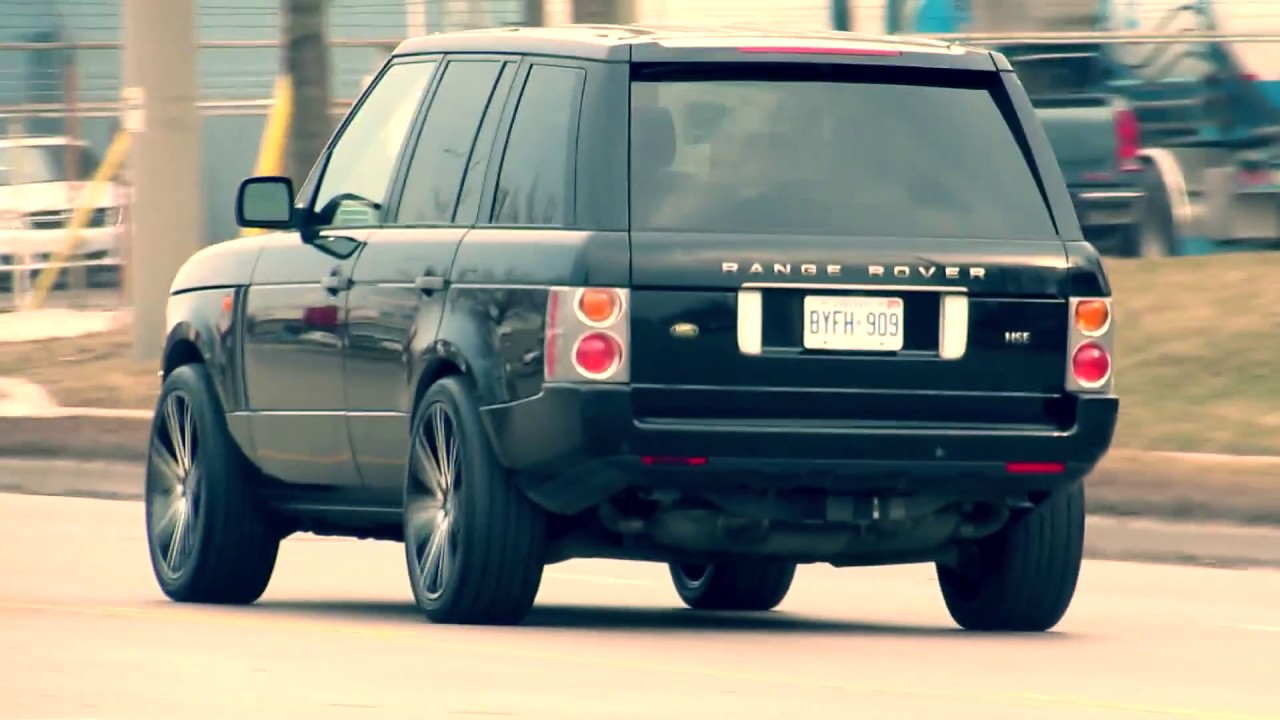 2005 land rover range rover with 22 inch custom black rims & pirelli