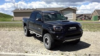 Lifted 2013 Toyota Tacoma Double Cab on 265/75R16 Tires