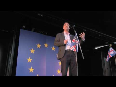 Tim Farron speaking on stage at Unite for Europe