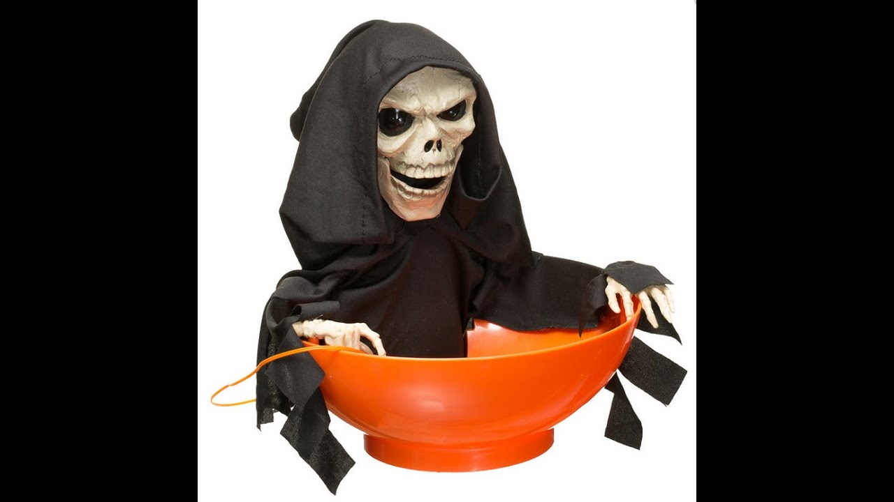 Halloween scary toy angry skeleton snapping Sam candy bowl - YouTube