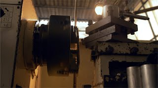 Shot of an old lathe machine working in an industry