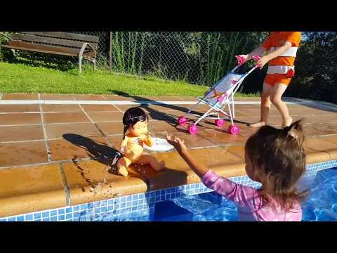 Baby Doll Pushchair / Little Girl Playing in the Pool
