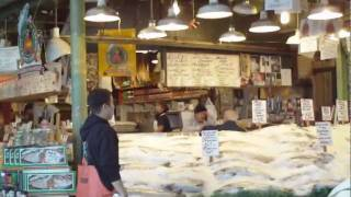 Catching and throwing fish at the Pike Place Fish Co. in Seattle, WA