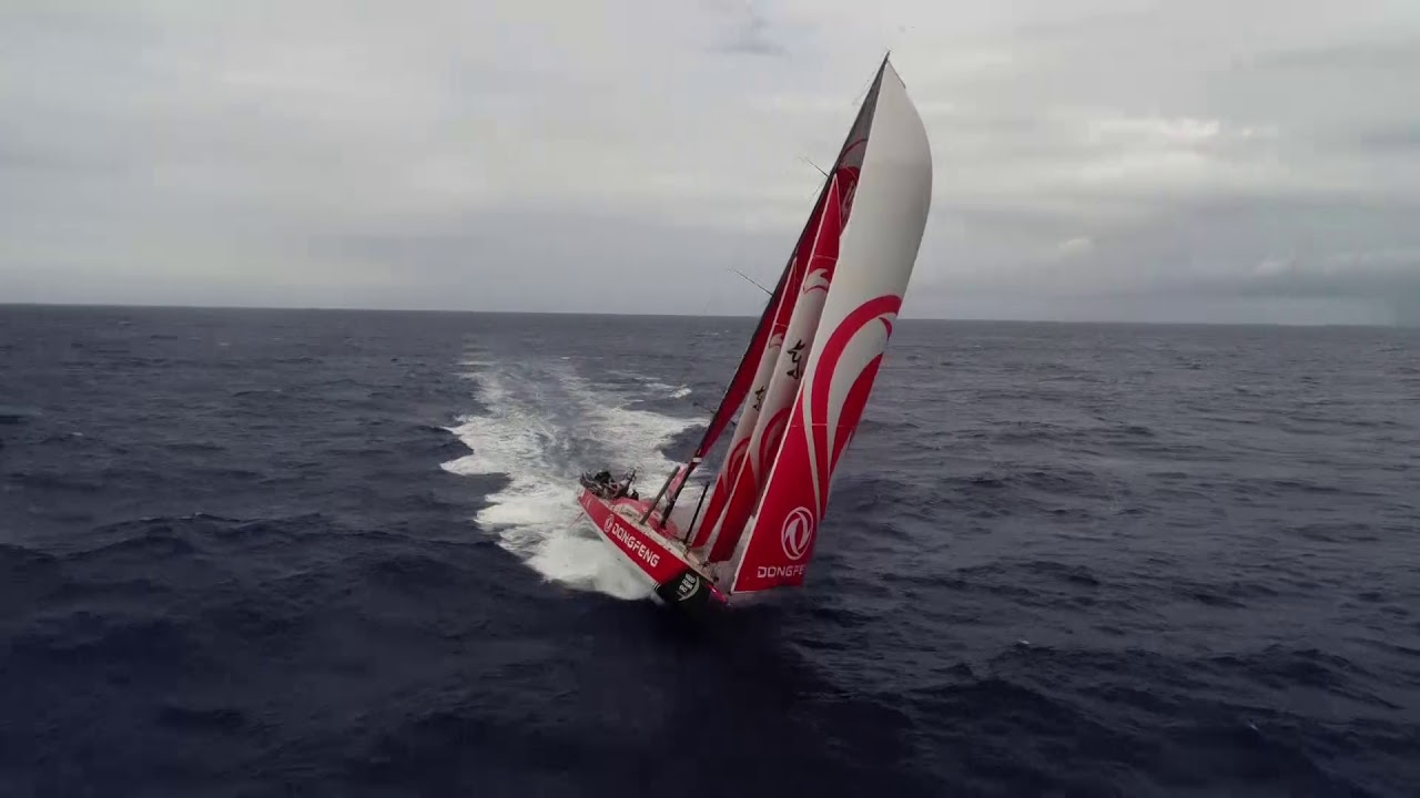 Fast-moving drone shots of Dongfeng surving on starboard.