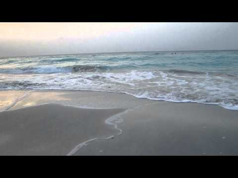 beautiful Varadero beach, rolling waves and sunset