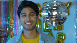 Handsome Indian guy happily smiling at the camera during Christmas/New Year celebration