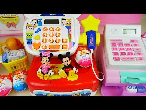 Disney Mart cash register and baby doll with Kinder Joy eggs toys