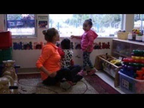 Teacher Welcomes Child (Spanish)