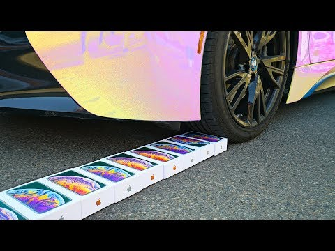Crushing 100 iPhones With Car - Challenge