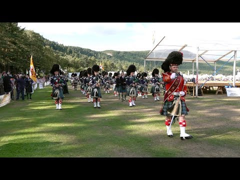 Massed Pipes & Drums return march after the 2018 Ballater Highland Games in Deeside, Scotland