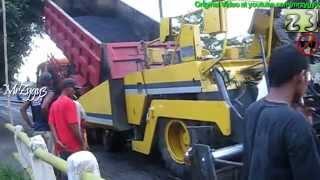 Dump Truck Loading Asphalt Paver