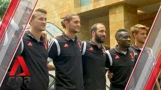 Juventus players greet fans, sign shirts in Singapore