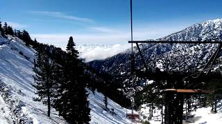 Riding the Sugar Pine chair lift above the clouds in Mt Baldy at 7,800 feet