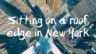 Sitting on a roof edge in New York