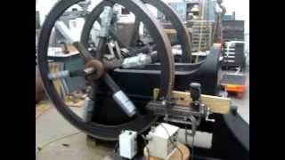 Machining flywheels in place on a 1884 Slide Valve Otto