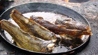 Разделка рыбы перед жаркой.