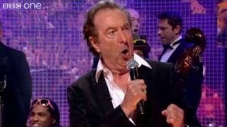 Eric Idle performs