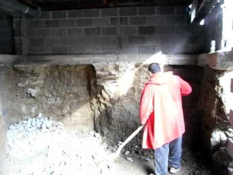 man digs nine foot basement under an existing house by