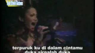 Krisdayanti concert. Anang almost falls