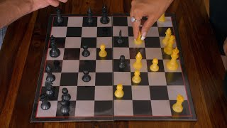 Indian woman with french manicured hands making her move at chess