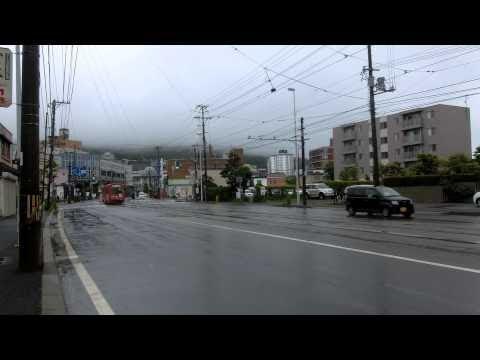 函館市電 Japan Hakodate City Tram ( Street Car ) 3004 And 2001 In The Rain