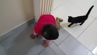 Baby fear by a pet cat