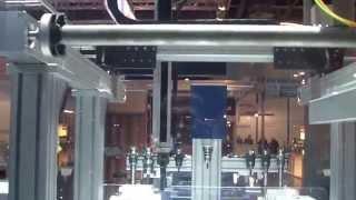 Загрузка и выгрузка манипулятором деталей на паллету станка